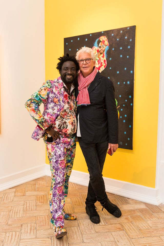 JP Mika, wearing one of his colourful patterned suits, alongside André Magnin