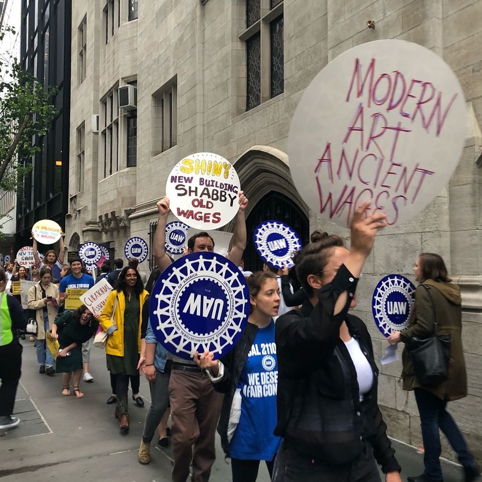 Protesters march on the street outside MoMA Thursday evening