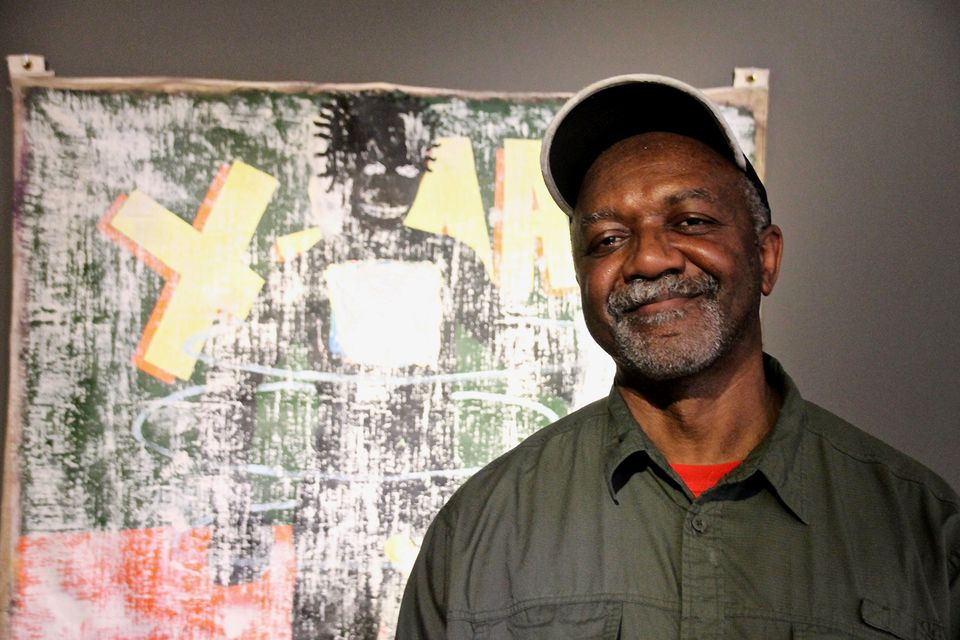 Kerry James Marshall with his work X-Man (1989)