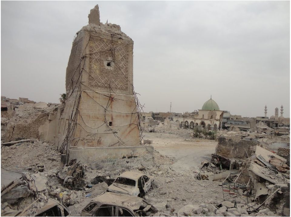 Scorched vehicles at the foot of the destroyed Al-Hadba' Minaret in Mosul, Iraq