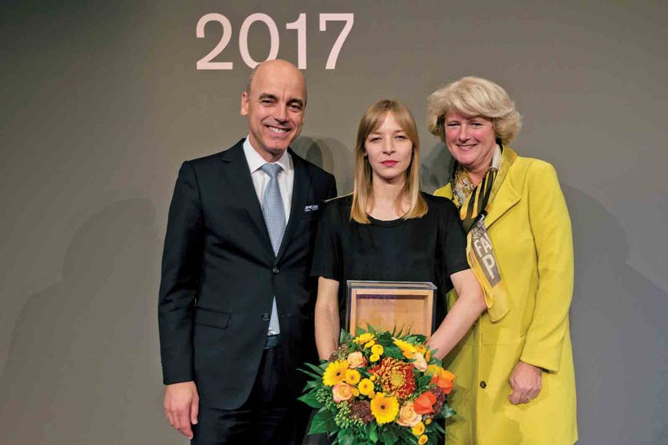 Agnieszka Polska (centre) is awarded the 2017 Berlin Nationalgalerie prize; she said she should have been paid for the work involved
