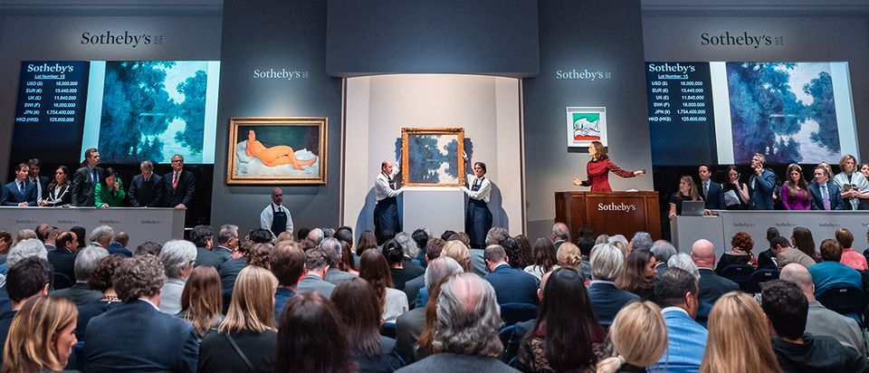 Modigliani's Nu couché (sur le côté gauche) (1917, left) in May at Sotheby's New York