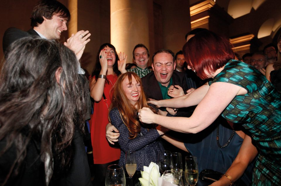 Glasgow-born artist Susan Philipsz is congratulated by friends and family after hearing the announcement that she has won the Turner Prize 2010, at the Tate Britain gallery, in London