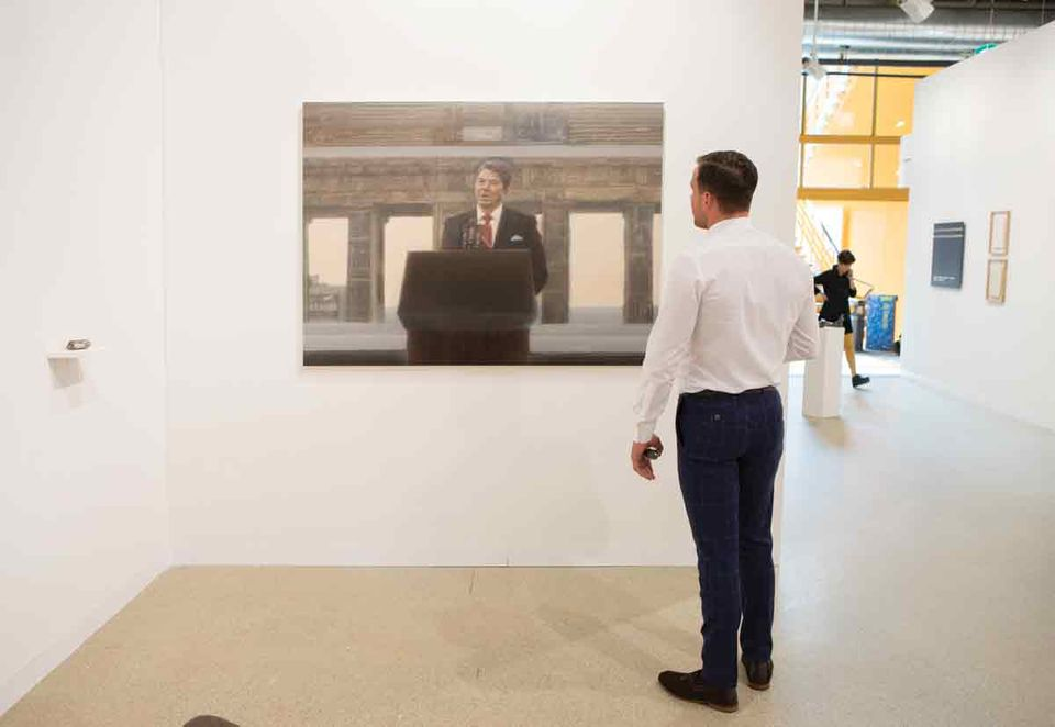 "Perhaps unexpectedly, there are several portraits of Ronald Reagan at the fair. For a series of works based on prominent figures who were assassinated or had attempts made on their lives, Gardar Eide Einarsson has painted Real Name: Ronald Reagan (2018), on show with Standard (Oslo). On Michael Werner's stand is a near-abstract portrait—you'll have to squint—called Reagan and Dots (1986) by Sigmar Polke. And Adam Gordon has made a new oil painting of the former president, Untitled (2018), which shows Reagan in front of the Brandenburg Gate in West Berlin in 1987, giving the speech in which he urged Mikhail Gorbachev, the leader of the Soviet Union, to ""tear down this wall""."