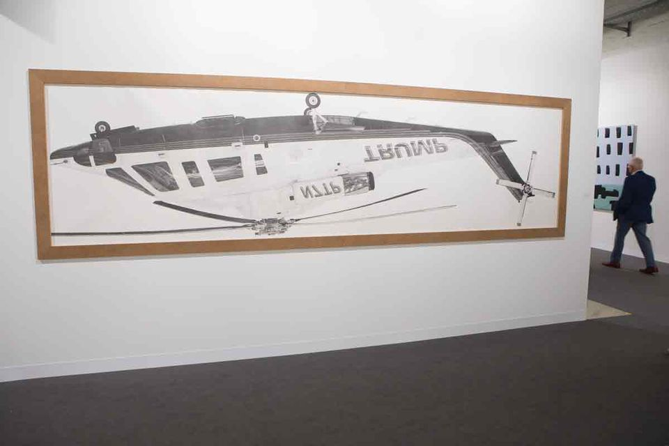 "Donald Trump's helicopter has been turned upside down in Karl Haendel's Inverted Mirrored Trump Chopper (2018), a large pencil drawing priced at $40,000. The Los Angeles-based gallery is also showing a second work featuring Trump, this time by Nicole Eisenman. The US artist has reworked The Tea Party (2012-17), which originally featured a ""generic rich fat man"" next to a figure of death, ""with a Trump face"", says the gallery's director, Susanne Vielmetter. The work is priced at $60,000."
