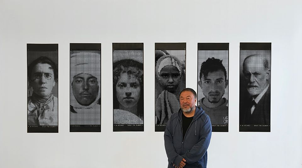 Ai Weiwei in front of his series of limited edition banners to mark World Refugee Day