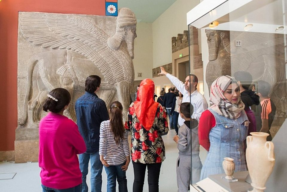 A Multaka guide takes a group on a tour of the Pergamon Museum