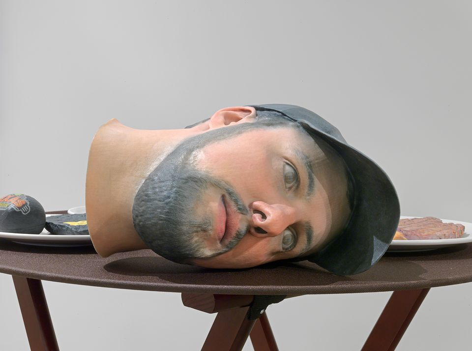 Josh Kline, Keep The Change (Texas Roadhouse Waiter's Head with Cap), 2018. 3D-printed sculptures in plaster with inkjet ink and cyanoacrylate, custom tray, wooden stand, 38 1/2 x 28 1/2 x 28 1/2 inches (97.8 x 72.4 x 72.4 cm).