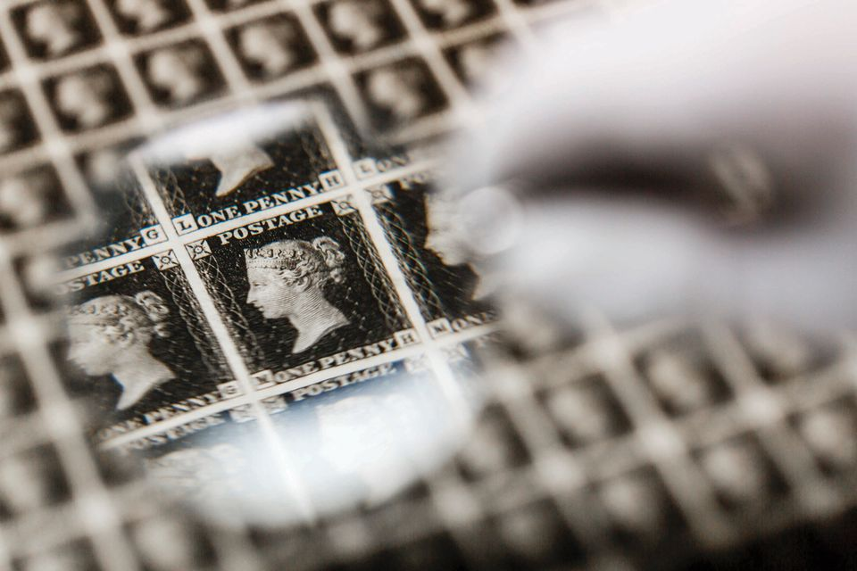 A priceless sheet of Penny Blacks - the world's first ever postage stamp – is inspected prior to heading abroad for the first time in a specially designed, bomb-proof briefcase at The Postal Museum on May 25, 2016 in London, England