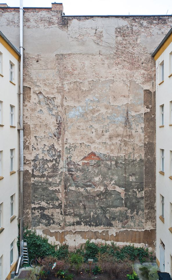 One of the remaining courtyard murals in central Berlin that will be restored