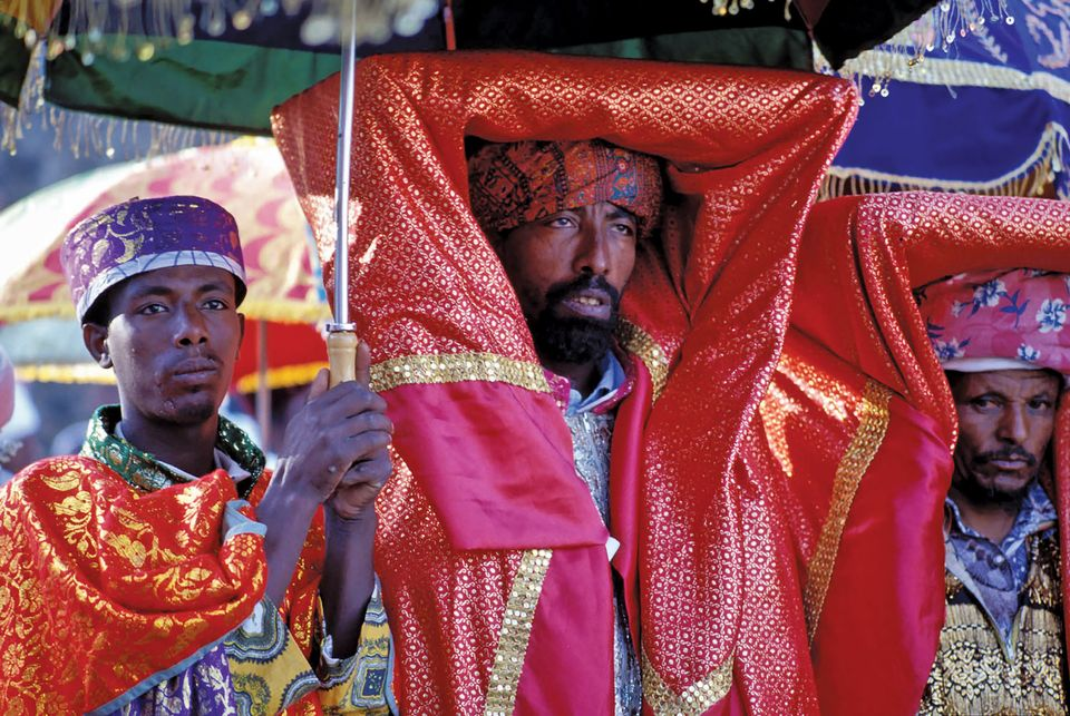 An Orthodox priest carries a covered tabot—a sacred object—in a ceremony in Gondar, Ethiopia