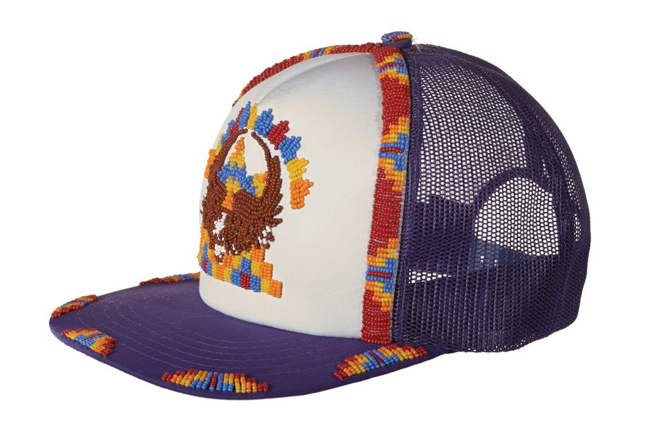 "America: ""Most people will be very familiar with the Native American material from the Plains. This display talks about the historic but also about the warrior societies that re-emerged in the 1950s and became part of the civil rights movement. They are still very strong now, particularly amongst Native American ex-servicemen and women. This Arapaho cap relates to that."""