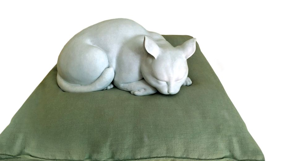 Monet's cat, bought at Christie's Hong Kong, is now back on his cushion in Giverny