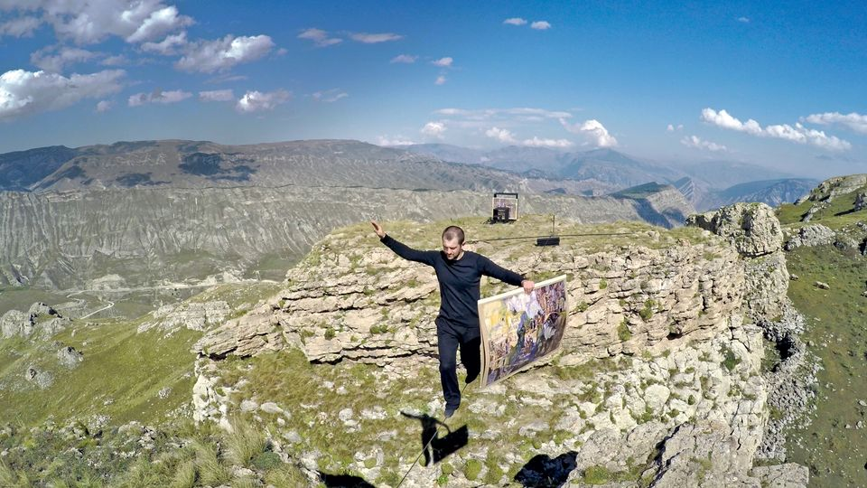 In Tightrope (2015), Rasul Abakarov, a tightrope walker, crossed a canyon in the Caucausus Mountains carrying copies of works from the Dagestani Museum of Fine Art
