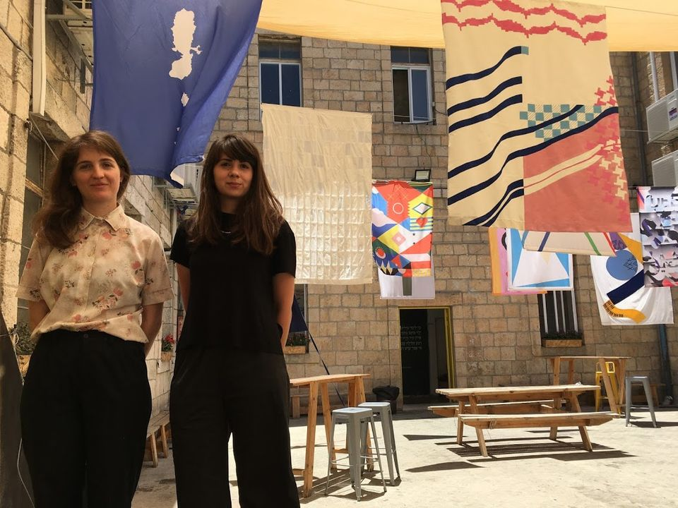 The curators Shy Ben Ari and Zohar Dvir at their exhibition of re-imagined Israeli flags at Alliance House in Jerusalem
