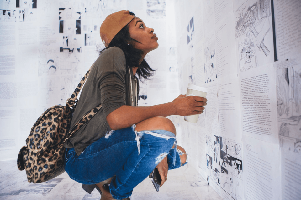 The actress Rosario Dawson views Writing on the Wall by Hank Willis Thomas and Baz Dreisinger when it was shown in New Orleans in 2015