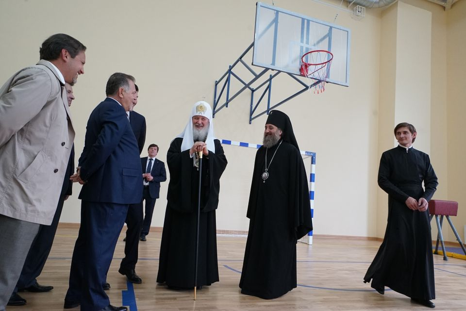 3182283 09/01/2017 Patriarch Kirill of Moscow and All Russia, center, and president of the international fund of private investments and chairman of the board of directors of Avtotor Vladimir Scherbakov, second left, visit the third building of the Orthodox gymnasium newly built in the center of Kaliningrad next to the region's main church, the Christ the Savior Cathedral, Kaliningrad.