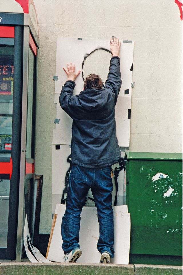 A rare photograph of the elusive Banksy at work in 2000