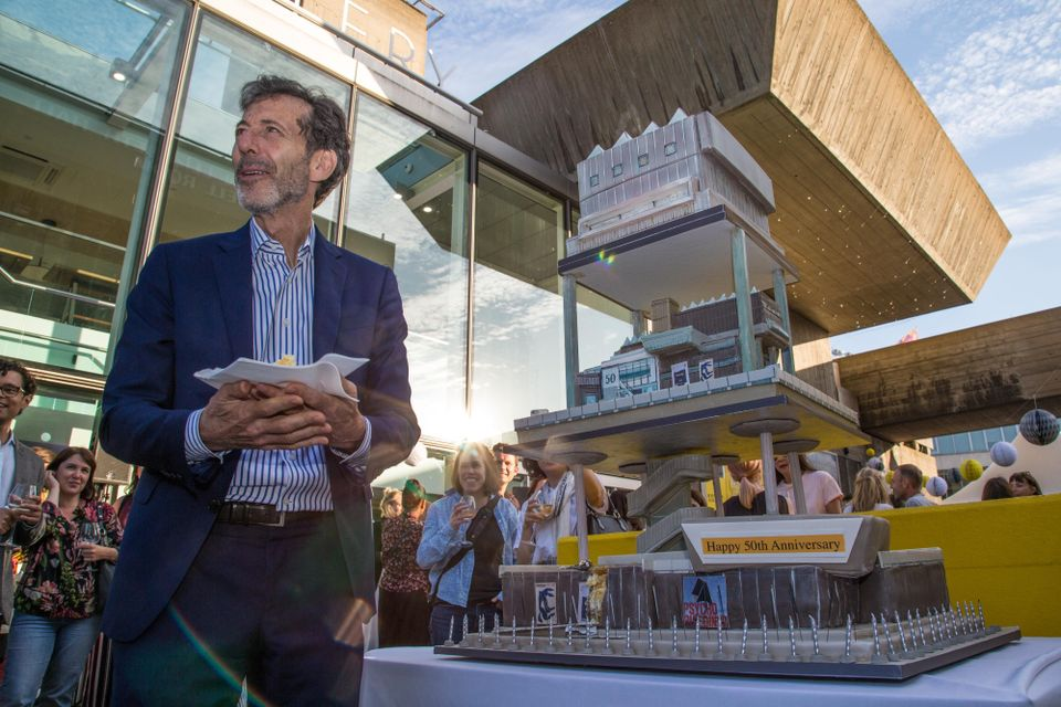 Ralph Rugoff hands out the Hayward Gallery cake at  its 50th birthday party