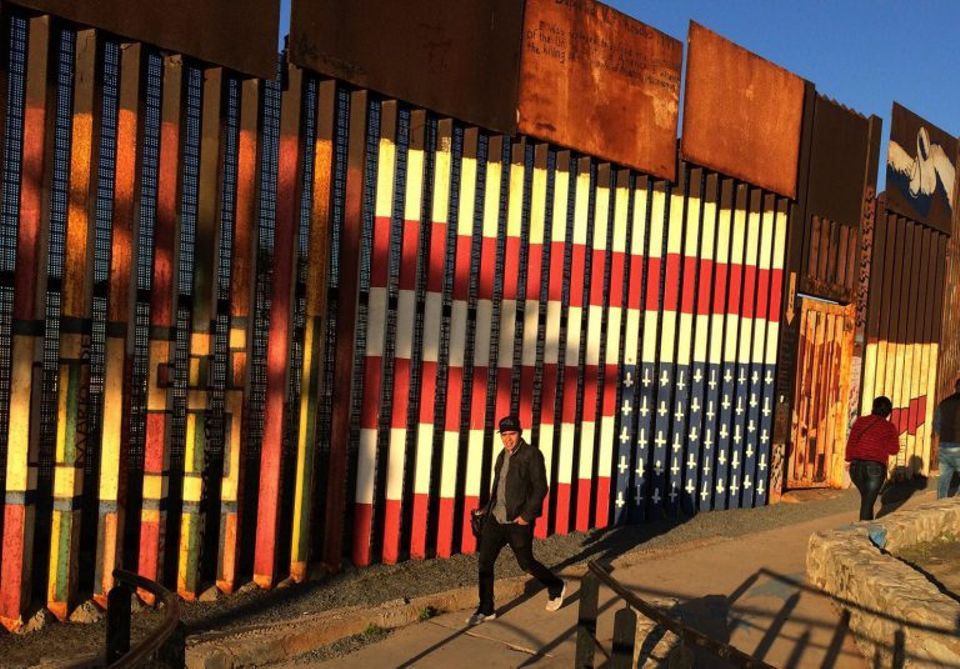 The upside-down flag mural painted by deported veterans on the Tijuana side of the US-Mexico border fence