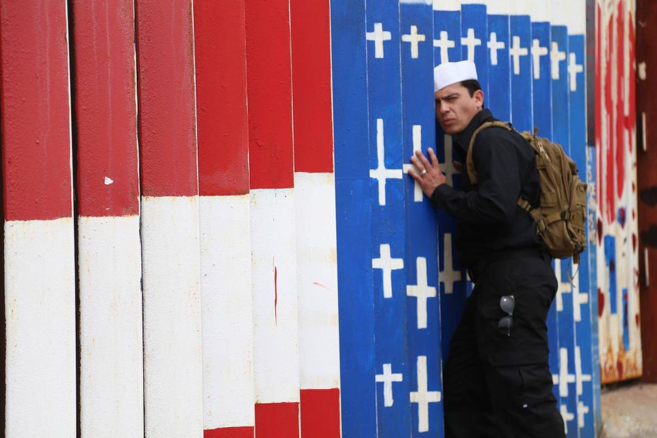 Deported US Navy veteran Alex Murillo at the mural he helped paint on the border