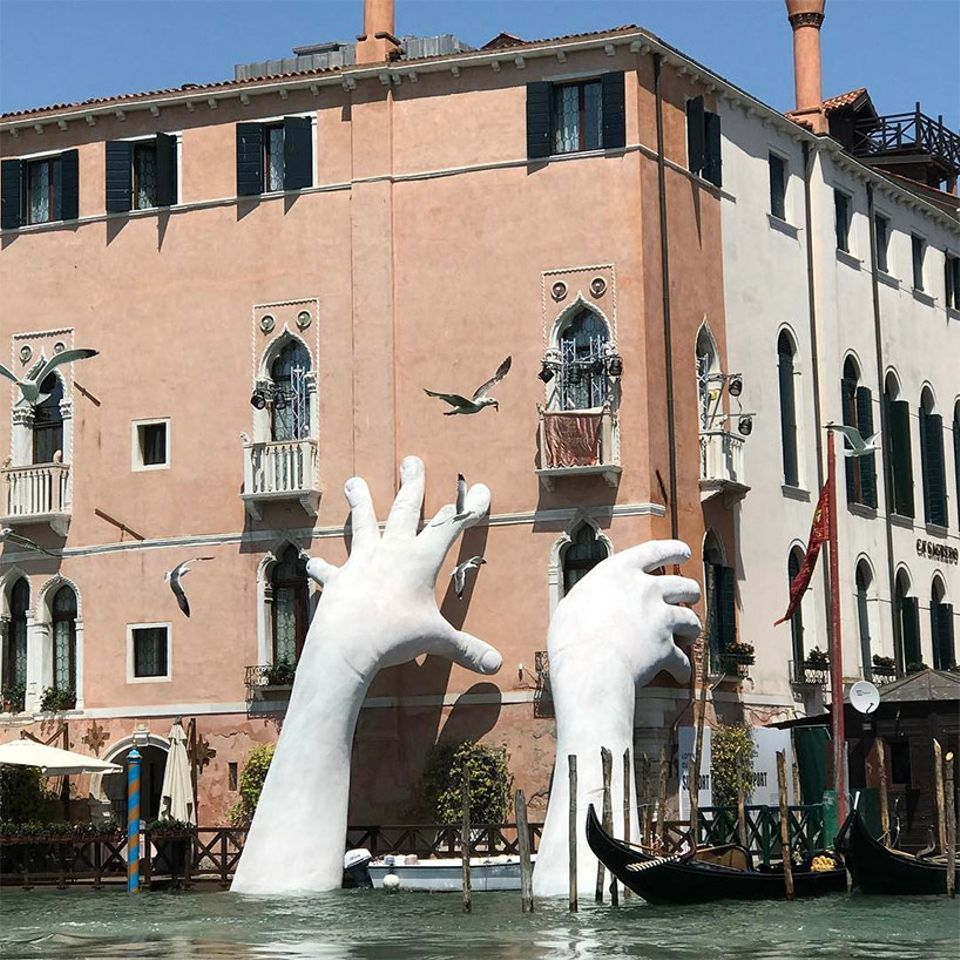 Support by Lorenzo Quinn, which was installed in Venice's Grand Canal