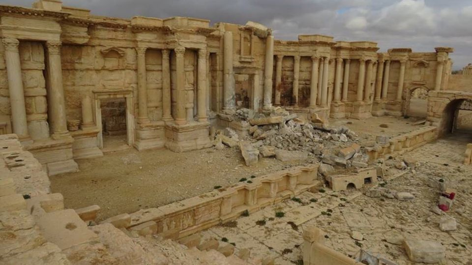 Damage caused by Islamic State at Palmyra's Roman theatre after the city was retaken by Syrian and Russian forces in March 2017