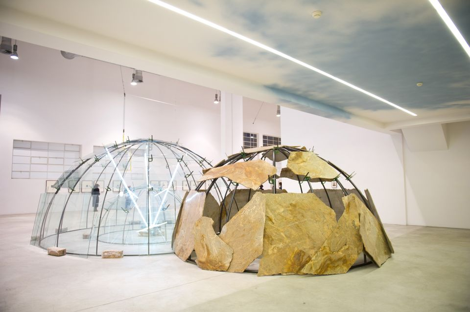 """For Merz, who began his career as a painter, """"the Igloo marked leaving two dimensions and conquering freedom"""", says the Pirelli HangarBicocca's artistic director Vicente Todolí, who organised the show in collaboration with the Torino-based Fondazione Merz. The igloo works are made of metallic frames covered with a variety of natural and industrial materials, from clay, glass and stone to words made out of neon. """"The range of materials was what really made the soul of the work,"""" Todolí says."""