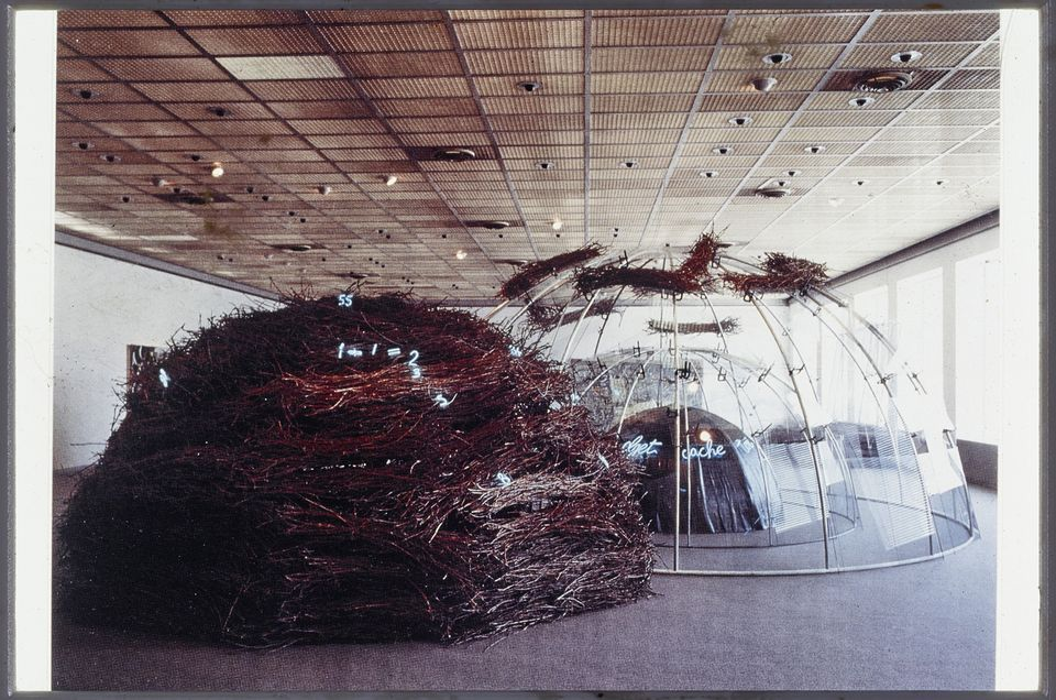 """The exhibition is based on the 1985 show of all 12 of Merz's igloo works of the time at the Kunsthaus in Zürich, organised by the pioneering curator Harald Szeemann. It was """"a kind of city of igloos"""", Todolí says, or what Merz called a """"Città irreale"""" (""""unreal"""" or """"fanciful"""" city). Organised chronologically, the HangarBicocca show includes works from 1968 to 2003, including his 1980s works that demonstrate how his igloos became increasingly complex in this decade. The Igloo del Palacio de las Alhajas (1982), on loan from the Reina Sofia in Madrid, for instance, made up of crystal, iron, quartz, slate, sand and heather branches, is a transparent double igloo that plays on the contrast of natural and human-made elements."""