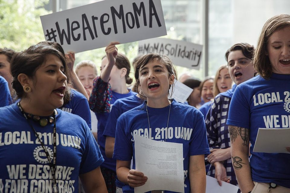 The protest by MoMA's union staff began in the lobby and eventually around 100 employees gather in a march around the block