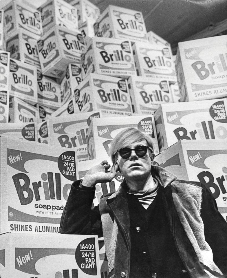Andy Warhol at the Moderna Museet in1968 with his original Brillo Boxes (1964)