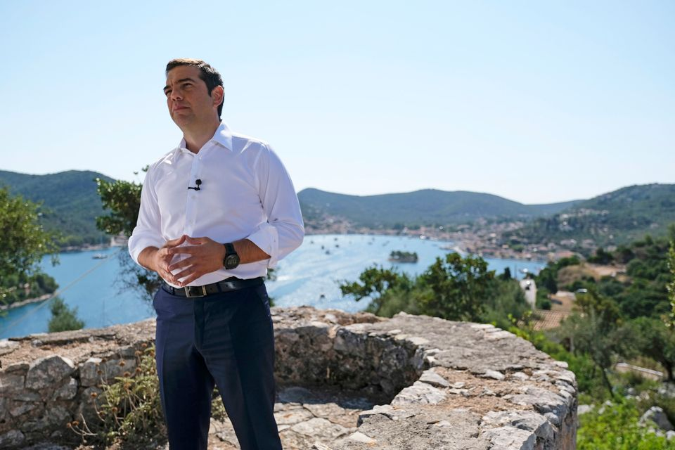 Prime Minister Alexis Tsipras stands on a hill in Ithaca overlooking the bay that the mythological hero Odysseus returned to after his ten-year voyage home
