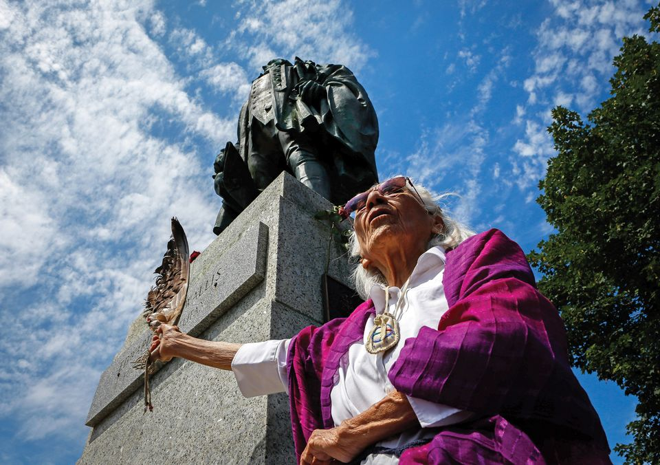 Isabelle Knockwood, an elder of the Mi'kmaq Nation, at the statue of Edward Cornwallis, who put a bounty on the heads of members of the indigenous group