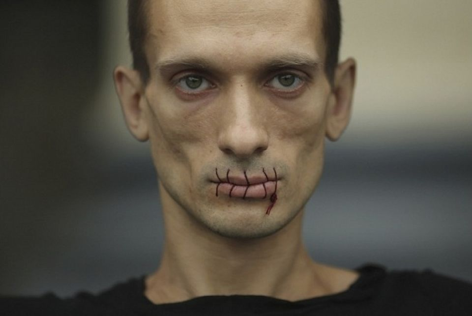 In one of his earliest performances in 2012, Pavlensky sewed his lips shut in protest against the jailing of members of the feminist punk band Pussy Riot