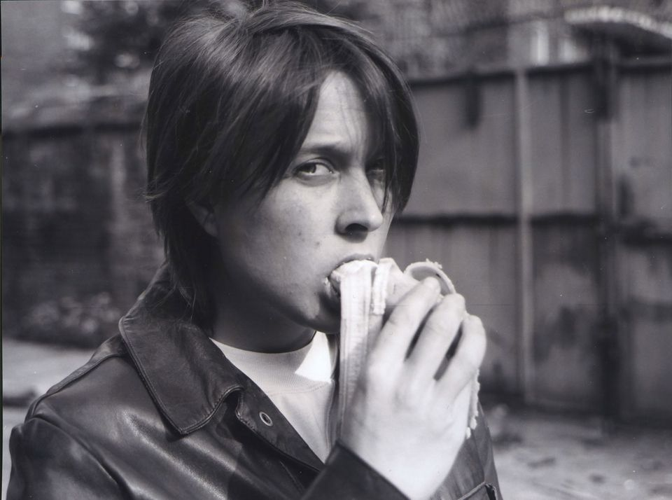Sarah Lucas, Eating a Banana, 1990. Black-and-white photograph, 41 3/8 x 44 3/8 in (105 x 112.8 cm).