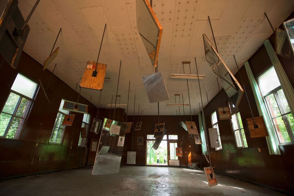 Mike Nelson's Mirror reverb (the blinding of a building, a notation for another) features a hospital's bathroom mirrors hung in a chapel