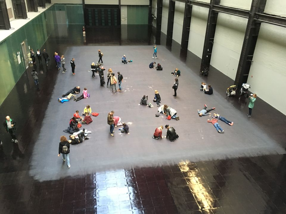 The heat-sensitive floor reveals the image of a Syrian refugee