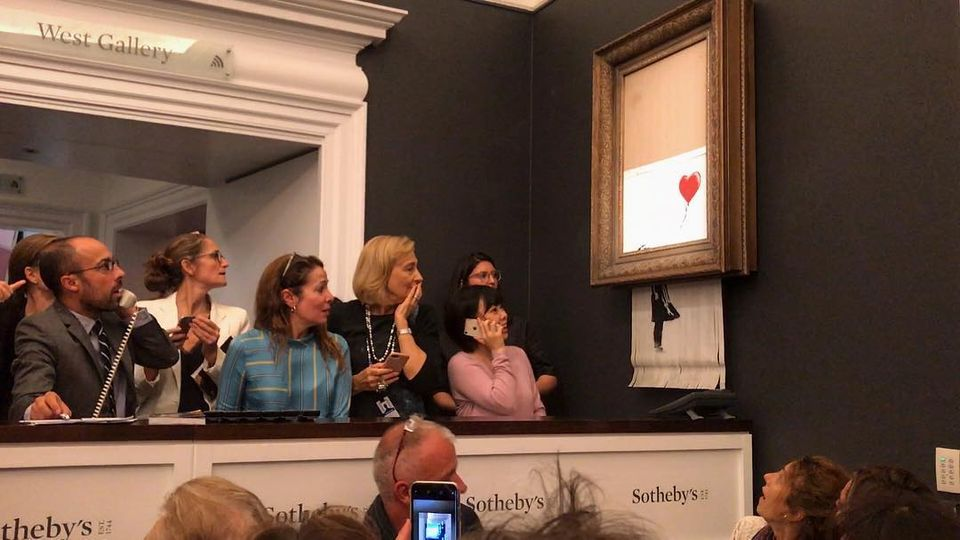 Going, going, gone...Banksy's Instagram post of the moment his million-pound work went through the shredder at Sotheby's
