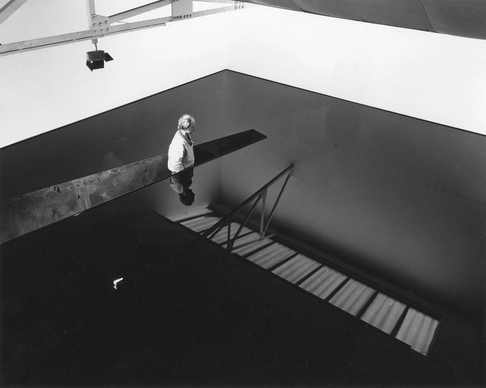 Richard Wilson in his installation of 20:50 (1987)