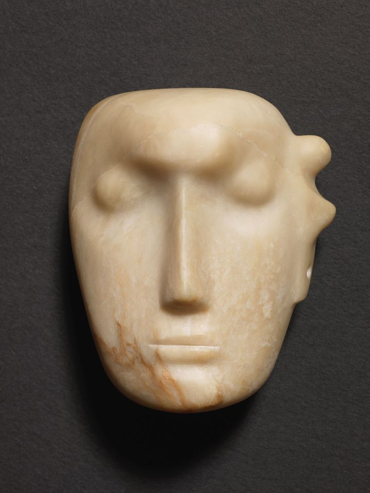 """Henry Moore, Mask (1929): Modern British and Irish Art, Bonhams, London, 14 November, Estimate £1m-£1.5m. Writing about his admiration for Pre-Columbian sculpture, the British sculptor Henry Moore cited its """"simple, monumental grandeur"""" and """"massive weightiness"""", which made it seem indestructible. While most of the masks from this series, made between 1924 and 1930, were carved from stone or cast concrete, this abstract piece is the only work from the series in a soft alabaster. The work is being offered at auction for the first time after being held in private hands since around 1945, though a mask from the series last surfaced at Sotheby's New York in 1997 and made a record sale of $398,500, doubling its high estimate."""