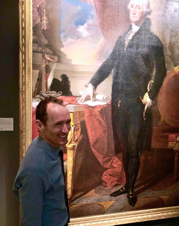 The Broadway producer Jeffrey Seller  with a portrait of Gilbert Stuart at TEFAF New York