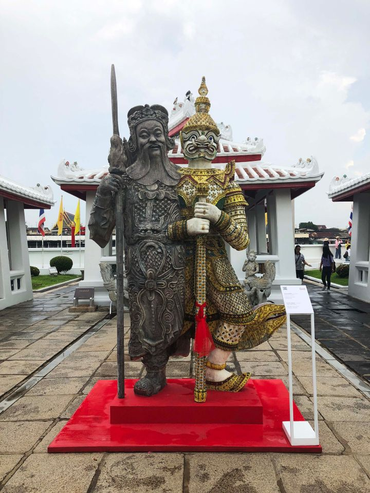 "The biennale has also placed 15 works inside three Buddhist temples along the Chao Phraya river. Obtaining permission to use these sacred sites which are visited by around 6,000 people every day required ""delicate and patient"" negotiation says Apinan Poshyananda. This fibreglass statue by Komkrit Tepthian (Thailand) Giant Twins, 2018 is at Wat Arun Ratchawararam (Temple of Dawn). It shows a Thai temple guardian joined together with a Chinese warrior, a fusion which speaks of Chinese trade with and migration to Thailand and the assimilation there of Chinese culture, the artist told The Art Newspaper."