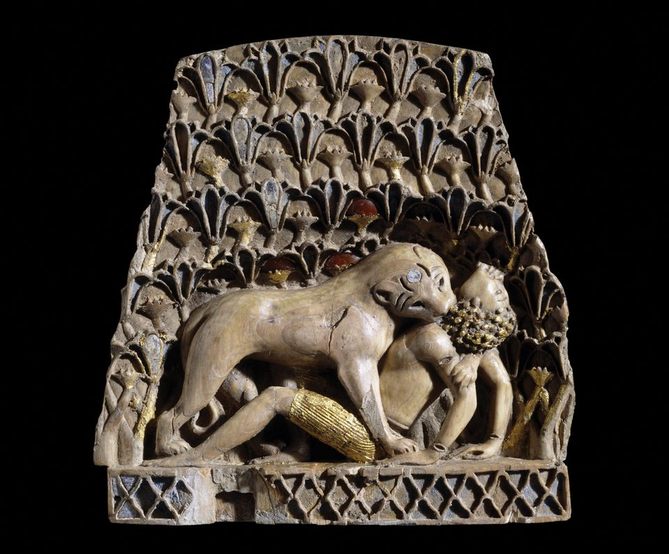 Ivory plaque from Nimrud of a lioness mauling a man (900-BC700BC), which is made from ivory, gold, cornelian and lapis lazuli
