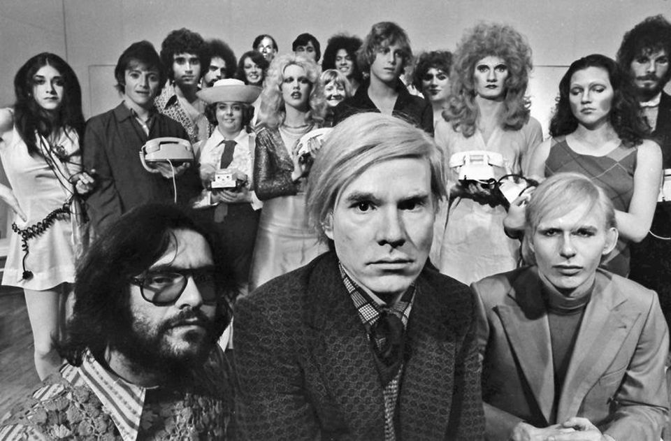 "Andy Warhol with the cast of his play ""Pork"" at La Mama, May 1971"