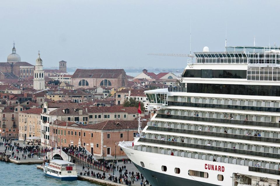 A cruise ship dwarfs Venice as it pulls into town