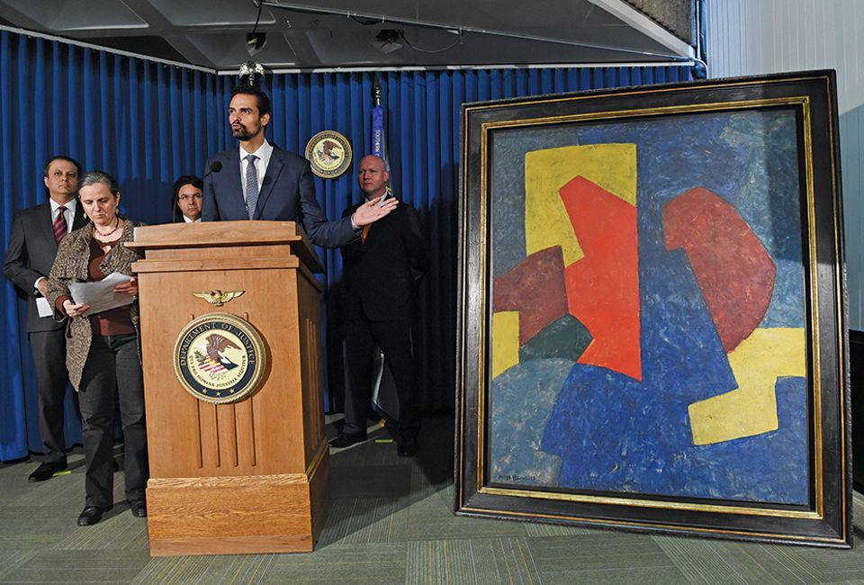 Brazil's secretary of justice with a painting believed to have been smuggled into the US by Edemar Cid Ferreira