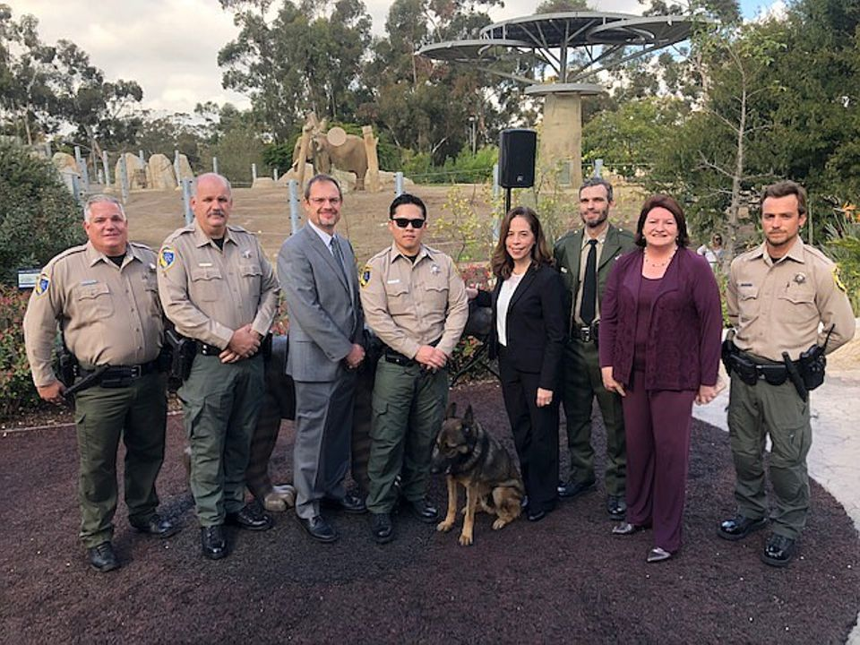 San Diego City Attorney Mara Elliott with officers from California's Department of Fish and Wildlife at the San Diego Zoo on 28 November