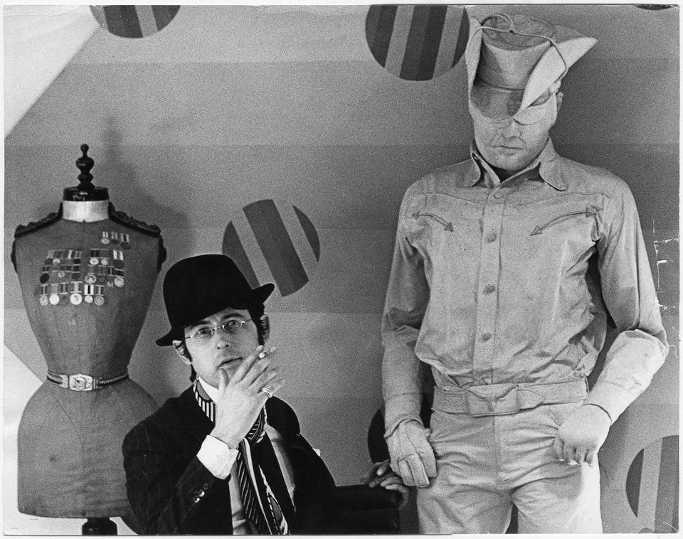 Robert Fraser at his gallery in 1966 with Jann Haworth's Cowboy (1964)