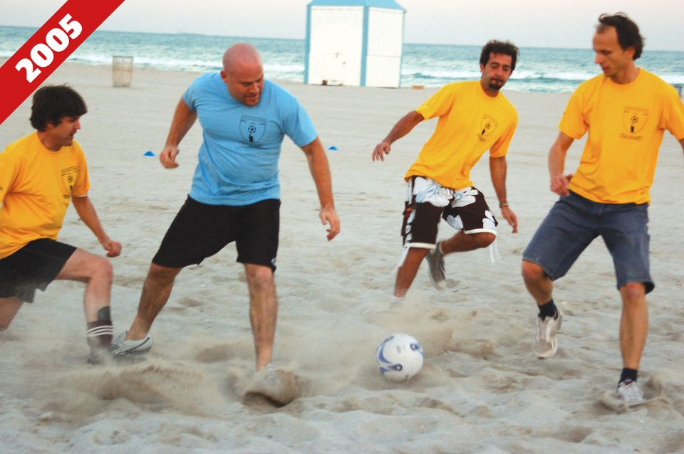 Marc Spiegler playing football on the beach