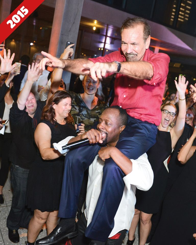 Collector Jorge Pérez getting a lift from  rapper Wyclef Jean